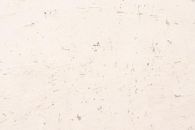 コンクリートの背景としてピンクのシームレスなテクスチャ