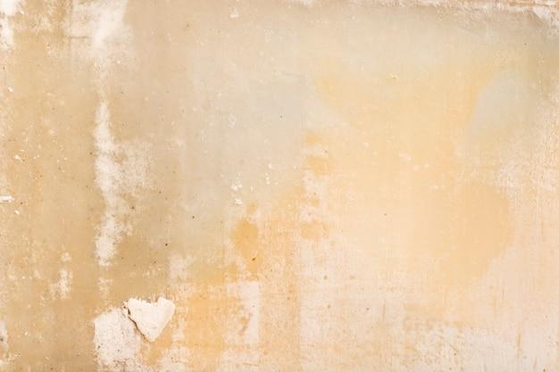 皮をむいたコンクリートのヴィンテージの壁の背景