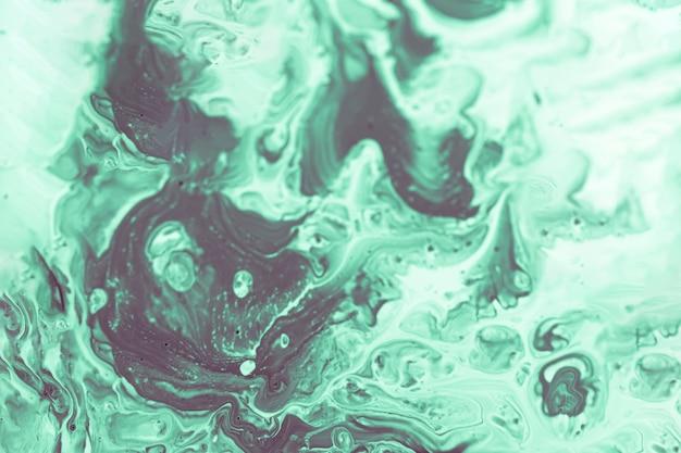 トップビューの緑と白の塗料混合物