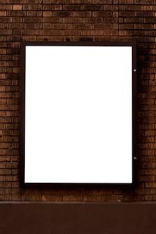 Макет рекламного щита на кирпичной стене