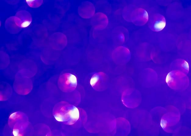 Расфокусированный фиолетовый фон блеск