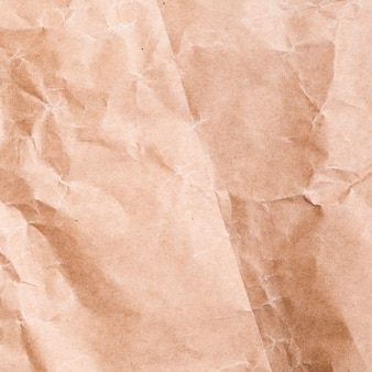 しわくちゃの紙の背景をクローズアップ