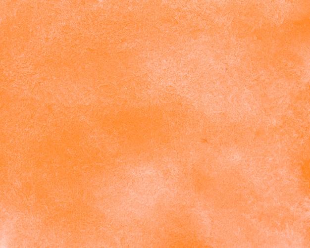 オレンジ色の抽象的な水彩インクの背景