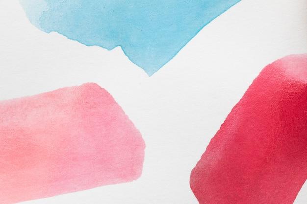 グラデーションの赤い色合いの手描きの汚れ