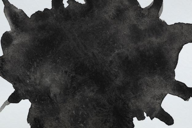 白い背景の水彩画の液体黒はね