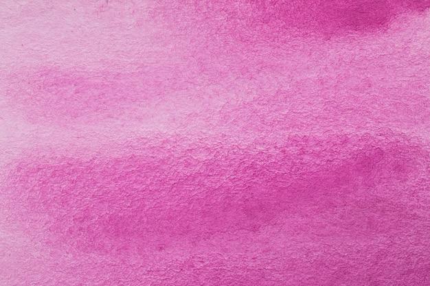 グラデーションピンクの抽象的な水彩インクの背景