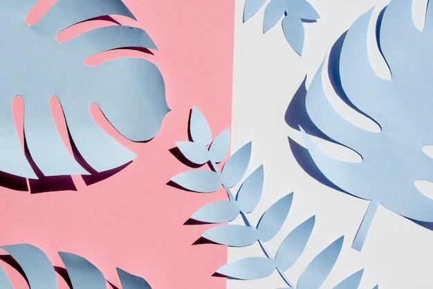対照的な背景に紙で作られた葉