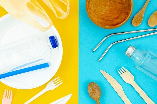 異なる使い捨てのプラスチックと紙のカトラリー