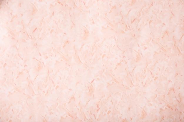 Крупным планом розовая фактурная штукатурка стен