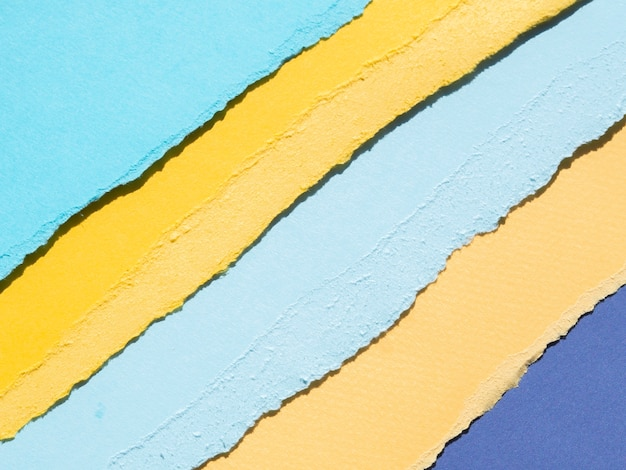 オレンジとブルーの抽象的な破れた紙の端