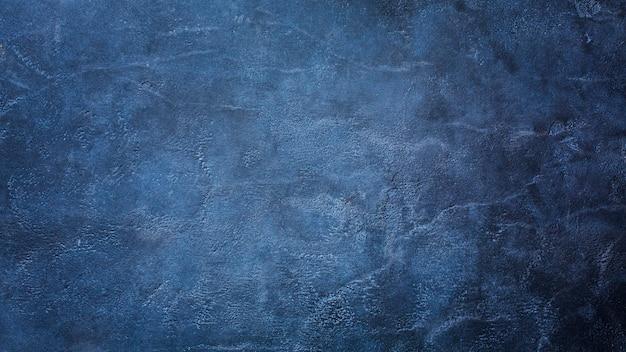 コピースペースで暗い青い大理石のテクスチャ背景