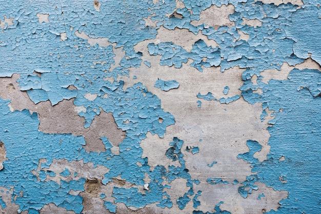コピースペースで皮をむいた塗られた壁のテクスチャ