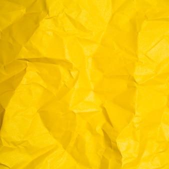 Желтая текстура бумаги с копией пространства
