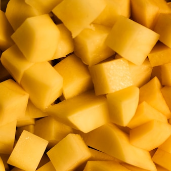 Крупным планом кусочки ананаса текстуру фона
