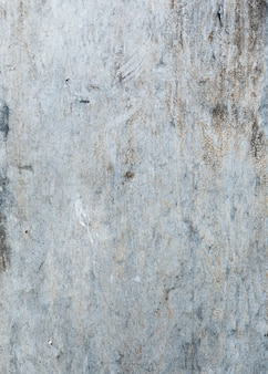 き裂を有する灰色の塗られた壁のテクスチャ