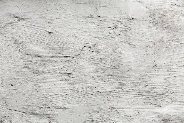 き裂を有する白い塗られた壁のテクスチャ