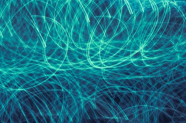 Длинный синий и зеленый градиент экспозиции текстуры неоновых огней