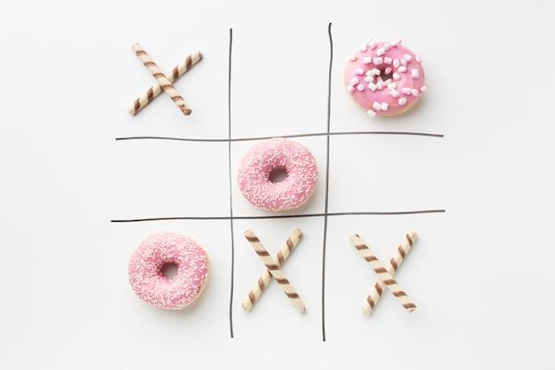 Пончики с концепцией крестики-нолики