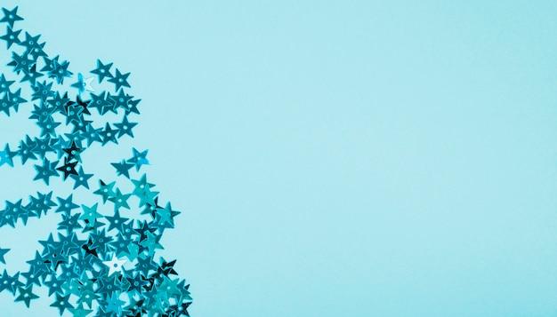 Голубая звезда блестки с копией пространства