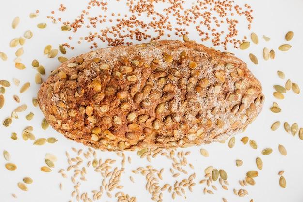 Хлеб украшенный крупами