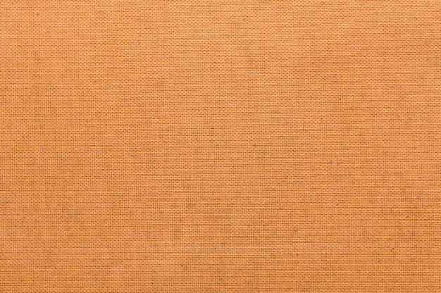 シンプルなオレンジ色の布の背景