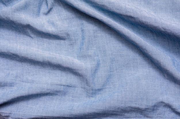 青い布のクローズアップの背景