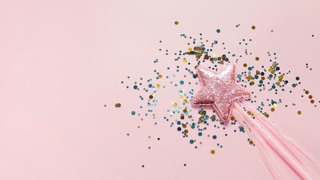ピンクの星とキラキラのトップビューに固執する