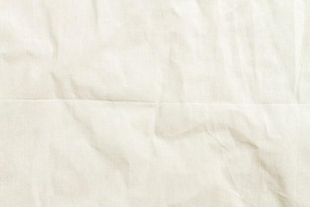 クローズアップテクスチャの白い布のスーツ