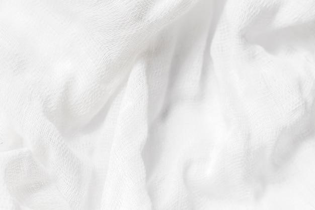 コピースペースを持つ白い布生地のテクスチャ