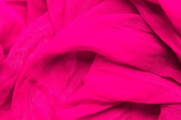 滑らかでエレガントなピンクの生地素材の質感