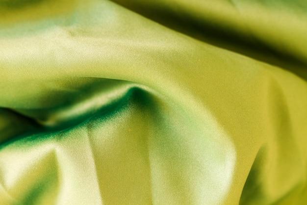 ねじれた波のある緑の素材の表面