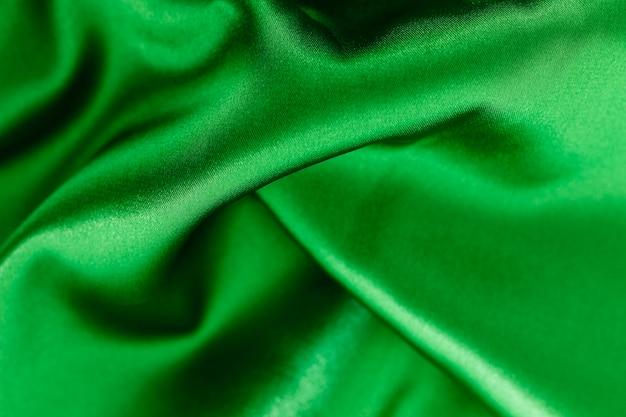 滑らかでエレガントな緑の布素材の質感