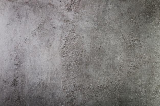 Темная цементная стена с грубой поверхностью