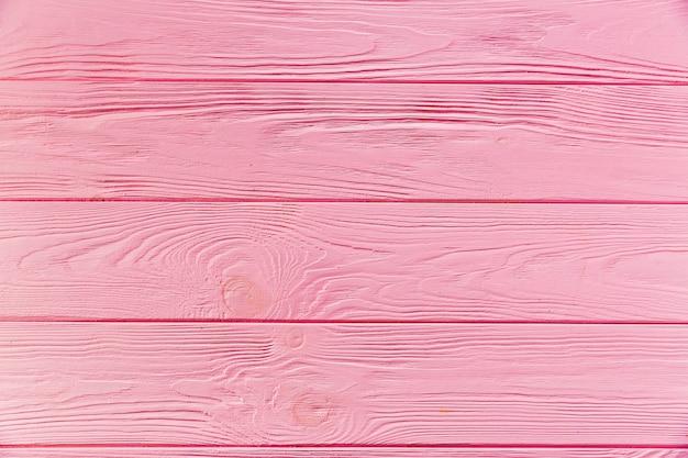 ピンク塗装の粗い木製表面