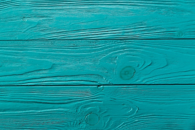 Деревянная поверхность синего цвета с сучками