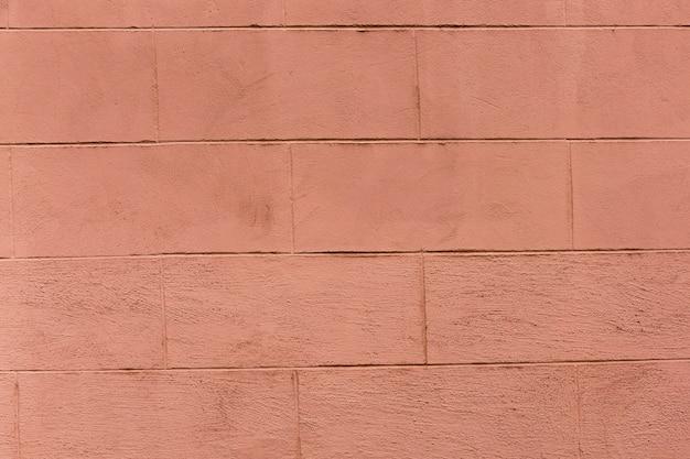 粗い外観の色付きレンガの壁