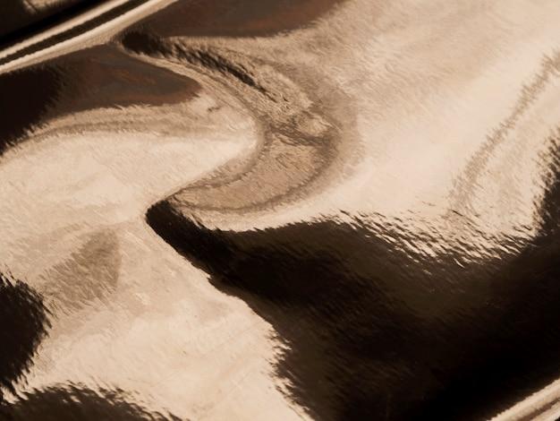 抽象的な油性ゴールドのテクスチャ背景