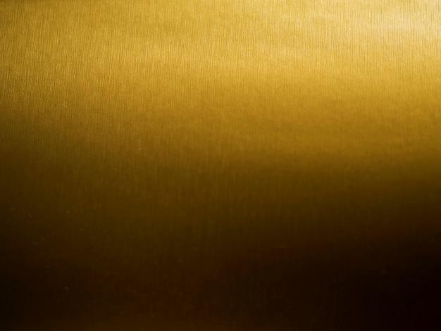 ゴールドのテクスチャ背景のグラデーション