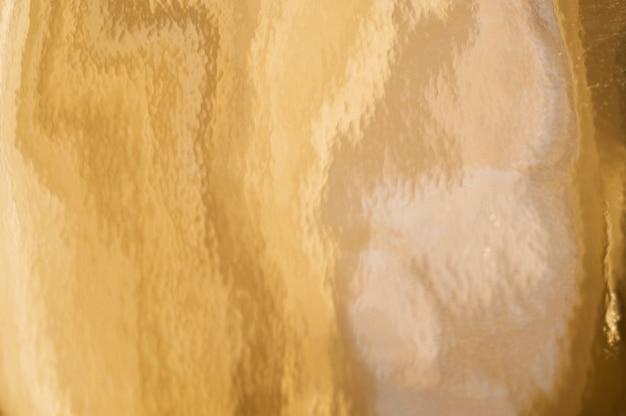 ゴールドのテクスチャ背景とグリッチ