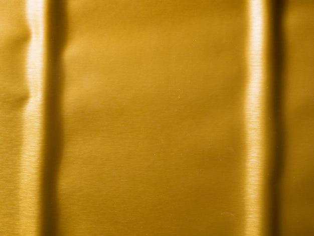ゴールドのテクスチャ背景と平行線