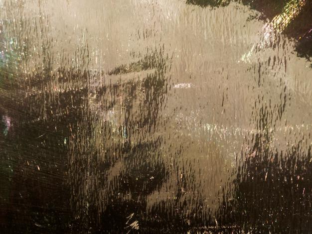 濡れた背景に金の粒子