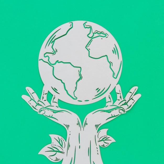 緑の背景に世界環境の日木製オブジェクト