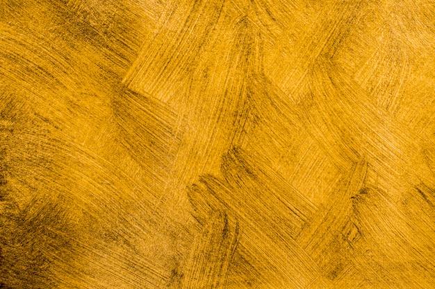 クローズアップ抽象的な黄金塗られた背景