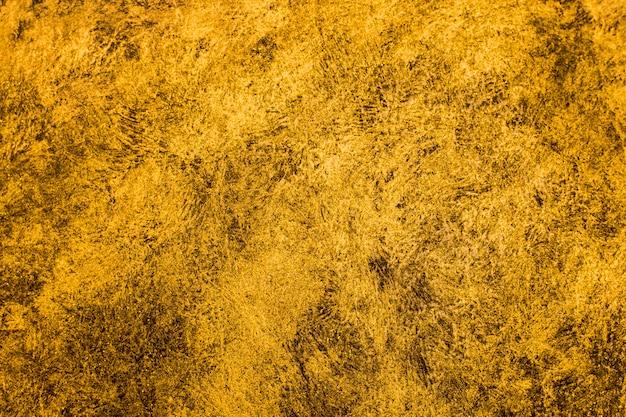 抽象的な黄金の塗られた背景