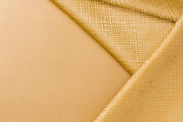 コピースペースを持つ黄金繊維テクスチャをクローズアップ