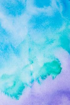 Абстрактный фиолетовый и синий фон акварелью