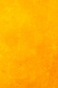 オレンジ色の水彩絵の具の抽象的な背景