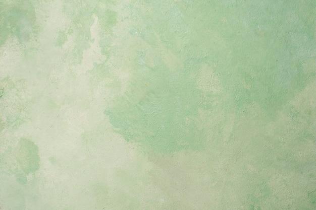 水彩の緑のペンキの抽象的な背景