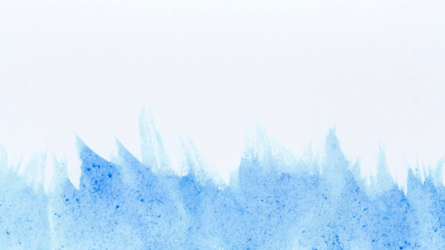 青い絵の具の抽象的な背景の水彩画の波