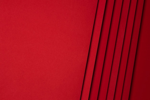 赤い紙シートの背景のフラットレイアウトの配置